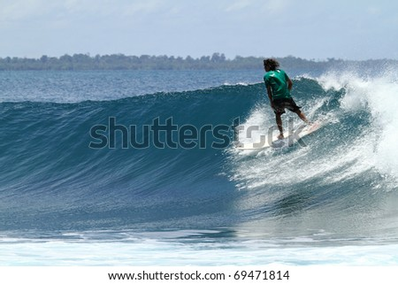 Extreme sport surfer on perfect wave - stock photo
