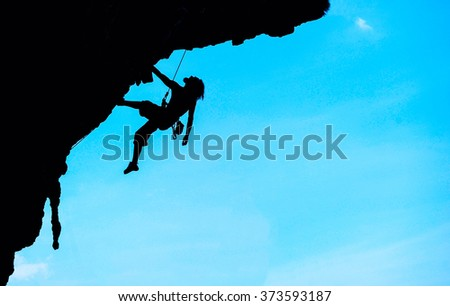 Extreme sport. The rock-climber during rock conquest - stock photo