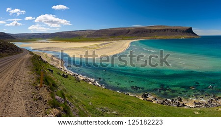 Extremely beautiful bay with mighty golden beaches and turquise sea in the West Fjords, Iceland. Panoramic photo - stock photo
