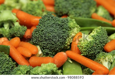 extremely close up fresh salad including broccoli and carrot - stock photo