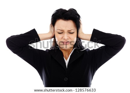 Extremely overworked businesswoman covering her ears in closeup pose, isolated on white background - stock photo
