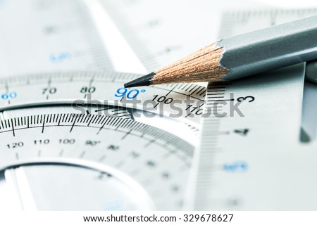 extremely selective focus a part of the silver pencil and precision measurement tool , concept of construction or building design drawing idea - stock photo