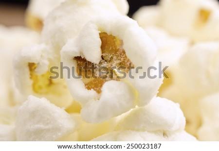 Extremes close-up image of sweet popcorn/ Close-up of sweet popcorn / Extremes close-up image of sweet popcorn. Focus Center  (corn, pop corn, snack) - stock photo