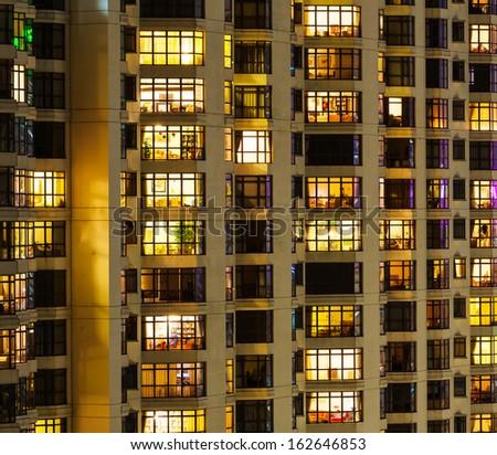 Extrior of apartment building at night - stock photo