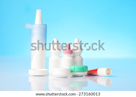 eye care fluids and drops including dry eyes eye drops and contact lens case  - stock photo