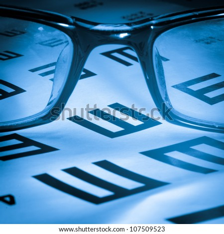 eye chart and glasses background - stock photo