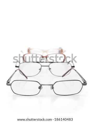 Eye glasses in on the table over white background,for medicine,eye testing, vision themes - stock photo