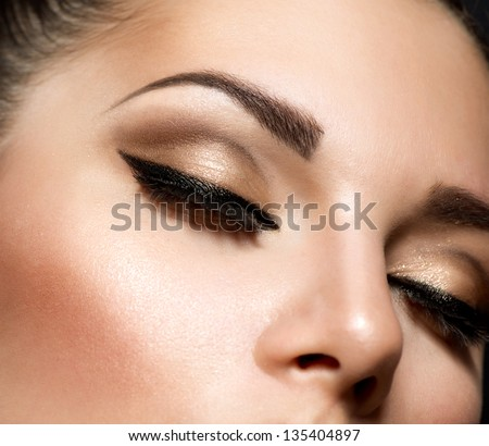Eye Makeup. Beautiful Eyes Retro Style Make-up. Holiday Makeup detail. Eyeliner - stock photo