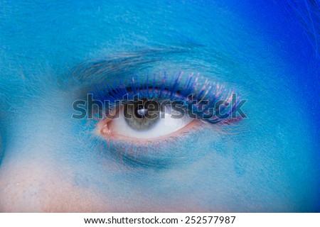 Eye Makeup. Creative eye makeup. False eyelashes. Blue shadows on the eyes. Beautiful eyeliner. - stock photo