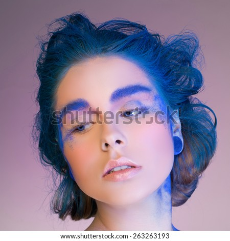 Eye Makeup. Creative eye makeup. False eyelashes. Blue shadows on the eyes. Beautiful eyeliner. - stock photo