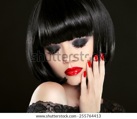 Eye makeup. Fashion Beauty Brunette Woman Portrait. Red lips and manicured nails. Bob hairstyle. - stock photo