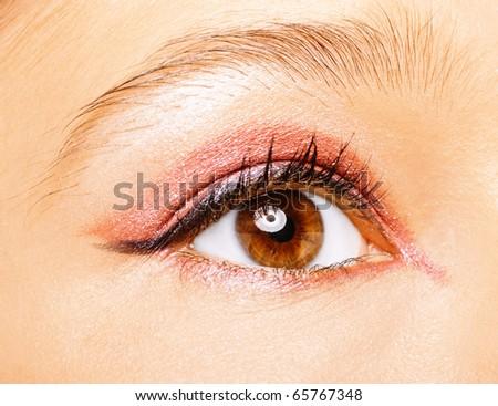 Eye of beautiful young caucasian woman close up. - stock photo