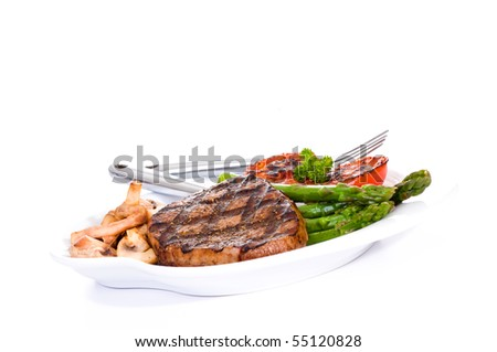 Eye of round steak with grilled mushrooms and vegetables. - stock photo