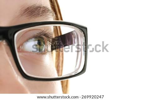 Eye of young girl with eyeglasses. - stock photo