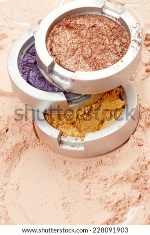 Eye shadow on face powder background - stock photo