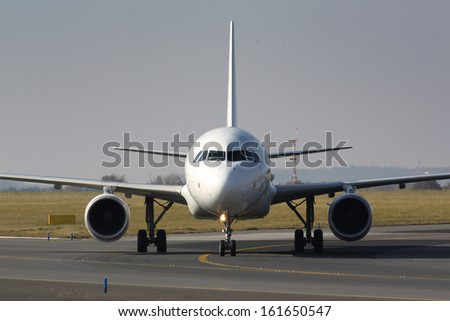 Eye to eye with taxiing plane - stock photo