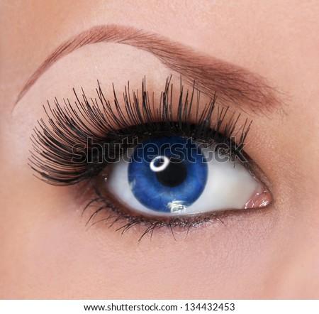 eye with long eyelashes. beautiful woman blue eye - stock photo