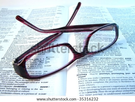 Eyeglasses and book - stock photo