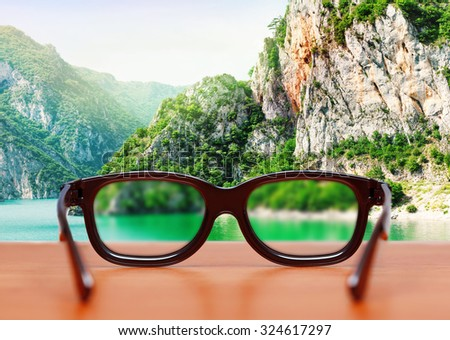 Eyeglasses in nature - stock photo