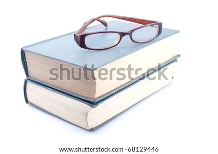 Eyeglasses on books  on white background - stock photo