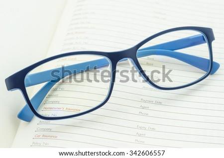 Eyeglasses on open diary planner. - stock photo