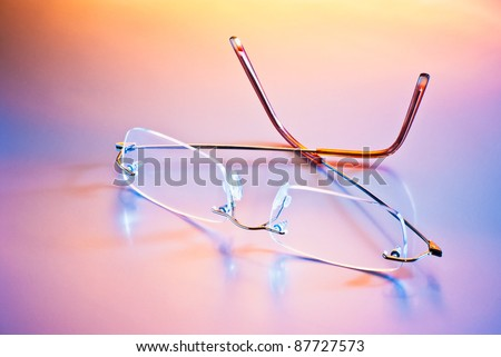 eyeglasses with reflection in mixed light - stock photo