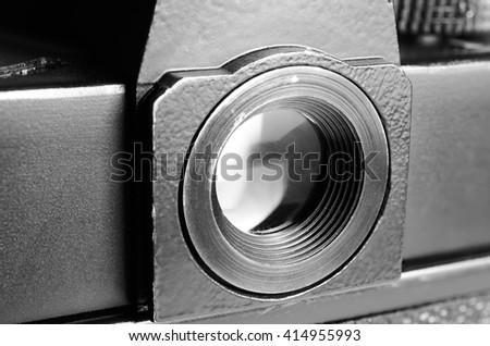 Eyepiece old film camera. Optical viewfinder. Close up view. Macro. Vintage photo toning. - stock photo