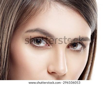Eyes beautiful woman face studio on white close-up - stock photo