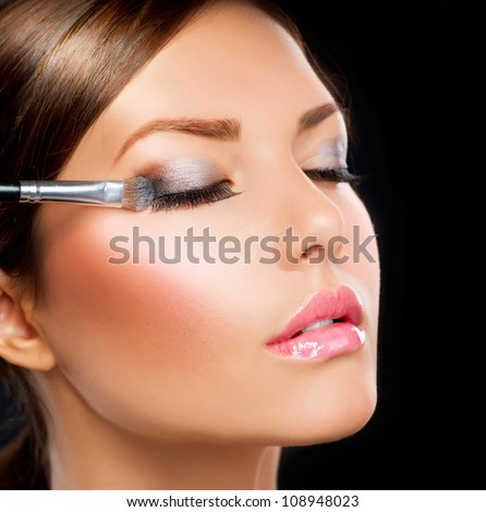 Eyes Makeup.Make-up.Eyes shadows. Eye shadow brush - stock photo