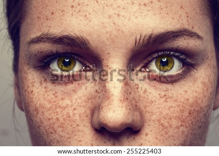 Eyes nose woman portrait with freckles - stock photo