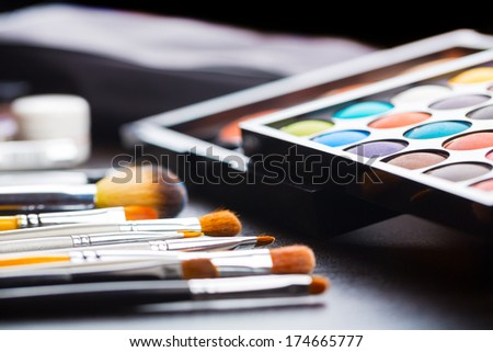 Eyeshadow makeup palette with brush - stock photo