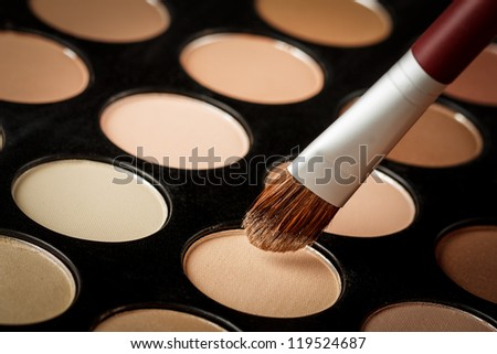 Eyeshadow palette with brush - stock photo