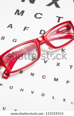 Eyesight test chart with glasses - stock photo