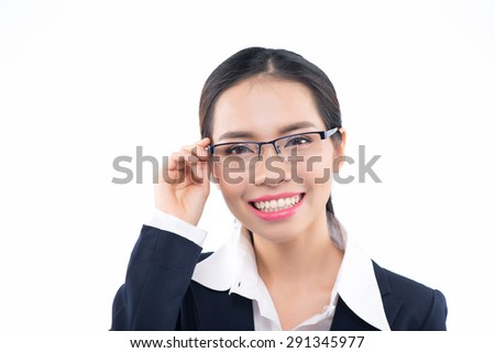 Eyewear glasses woman happy holding showing her new glasses smiling on white background. Beautiful young Asian Chinese female model in her twenties. - stock photo