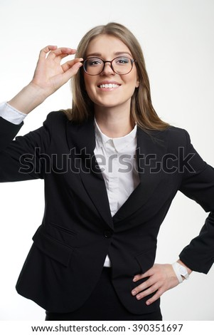 Eyewear glasses woman happy holding showing her new glasses smiling on white background. Beautiful young female model in her twenties. - stock photo