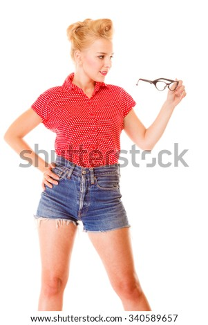 Eyewear. Young blonde woman beautiful girl retro hairstyle holding glasses studio shot isolated on white - stock photo
