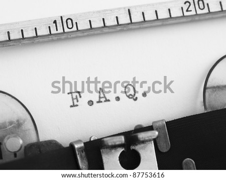F.A.Q. on the typewriter - stock photo