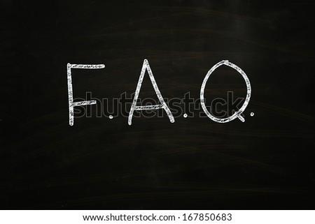 f.a.q. written with white chalk on blackboard - stock photo