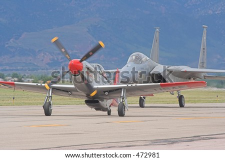F-15 and P-51 taxiing - stock photo
