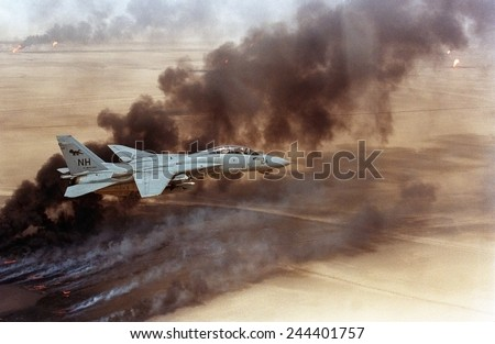 F-14 fighter in flight over burning Kuwaiti oil wells set on fire in March by retreating Iraqi forces were still burning on Aug. 1 1991. - stock photo