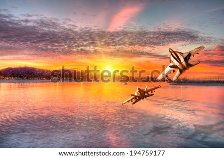 f 18 squadron flying over the sea - stock photo
