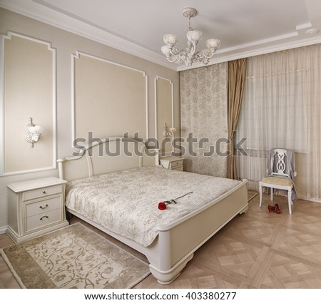 fabric, accessories for curtains, Interior of the luxury bedroom with classic bed and curtains and rose on the bed - stock photo