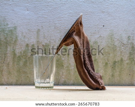 fabric bag make coffee in glass on wooden table - stock photo