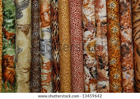 Fabric bolts - safari prints - stock photo