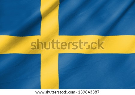 Fabric Flag of Sweden - stock photo