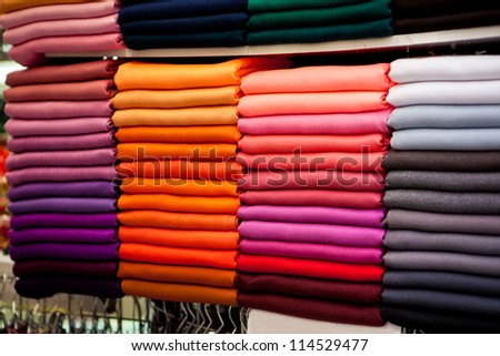 fabric of different colors in the stores - stock photo