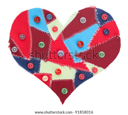 fabric scraps heart with sewing buttons isolated on white. Valentine's Day - stock photo