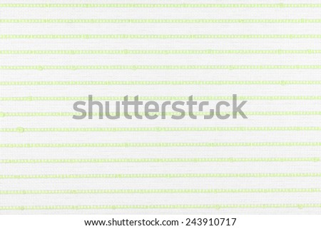 fabric texture with a green simple striped embroidery. Can be used as background. - stock photo