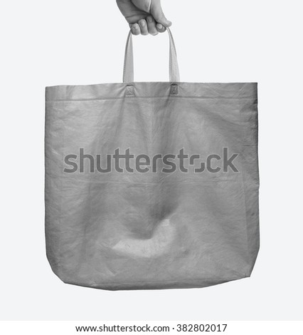 Fabric tote green bag MockUp with handle isolated on white background - stock photo