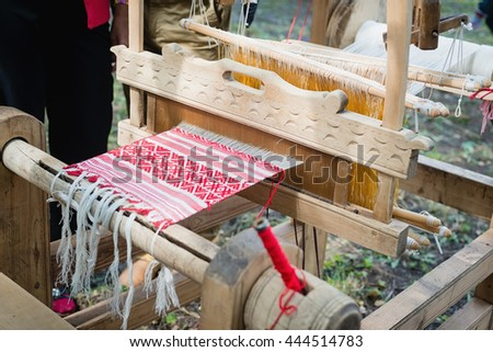 fabric with a shallow depth of field woven in a loom - stock photo